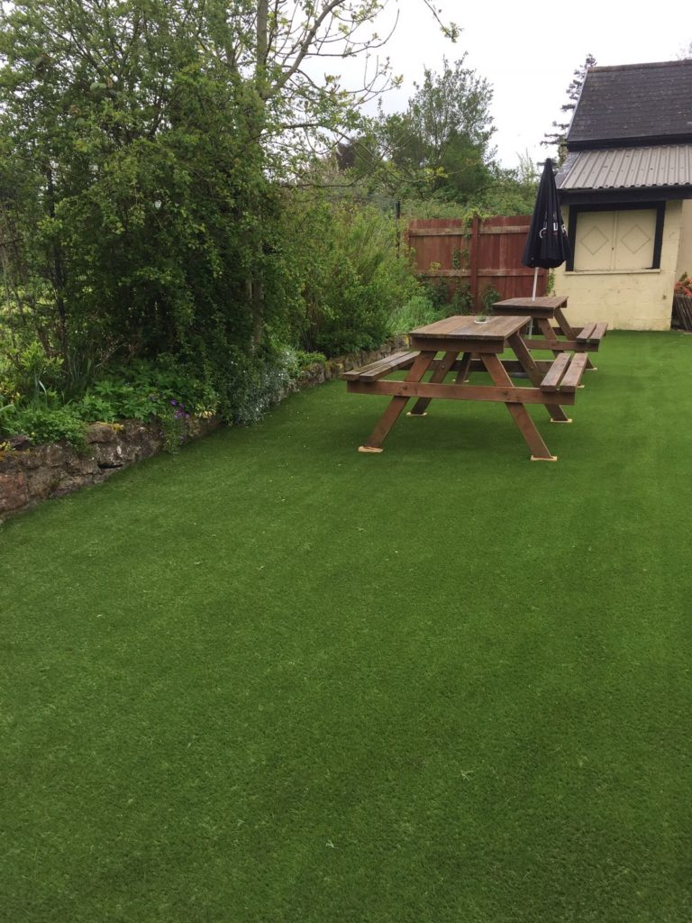 Artificial grass installation at Fox and Hounds pub